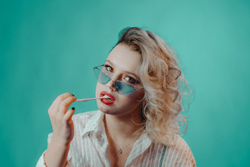Girl in glasses with chewing gum