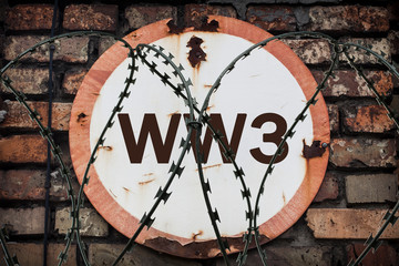 The inscription on the round rusty sign of the Third World War. War Risk Warning