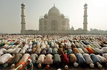 Indian Muslims take part in Eid prayers at Shahi Masjid outside the Taj Mahal in Agra.