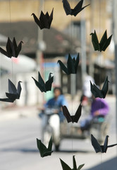 Mobile of paper birds displayed outside shop in Yala.