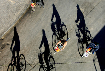 Chinese people ride their bycicles on a sunny autumn day in Beijing's city centre.