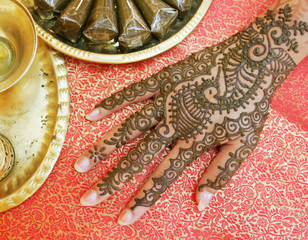A Malaysian Hindu shows her hand painted with henna ahead of Diwali celebration in Kuala Lumpur.