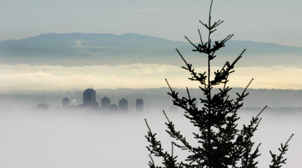Canadian west coast city of Burnaby sits in morning fog.
