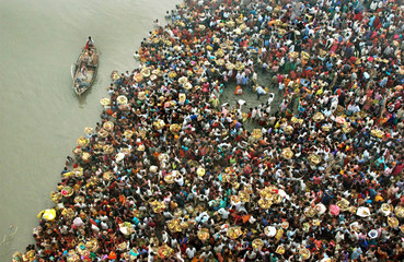 Hindu devotees crowd to worship the Sun god on the banks of river Ganges in Patna.