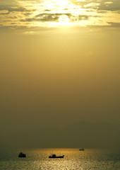 Ships sail at early sunrise on Arabian Sea near Bombay.