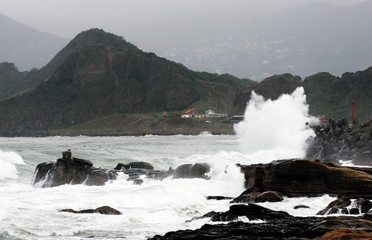 Large waves caused by Typhoon Nock-Ten pound Taiwan's northeastern coast near Keelung city.