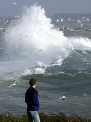 Waves crash in Brittany as high winds beat western france.