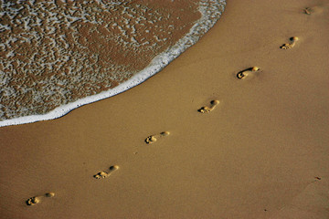 Footprints are left on the shore of Sydney's Bronte Beach.