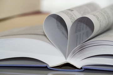 Close-up of heart shape from paper book