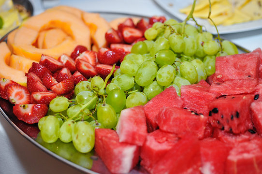 fresh fruit melon strawberry pineapple and grapes