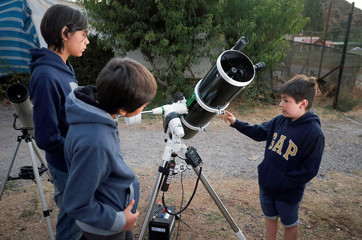 Ricardo Barriga, 10, speaks and teaches astronomy to younger in hopes of raising money for his own astronaut suit, Pirque