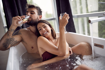 Relationship. Beautiful man and woman is bathing together.