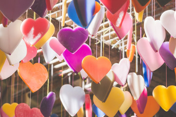 Colorful of hearts made of candle pattern designs hanging from c