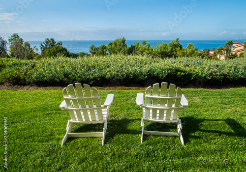 Outstanding Group Of Two White Adirondack Chairs On Green Lawn Facing A Pdpeps Interior Chair Design Pdpepsorg