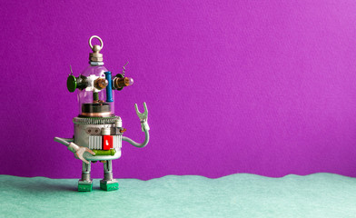 Wall Murals UFO Funny glass head ufo robot on a violet green background. Futuristic robot humanoid toy with raised hand. Copy space