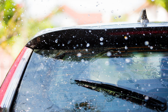 The wiper on rear window of a car with drop rain