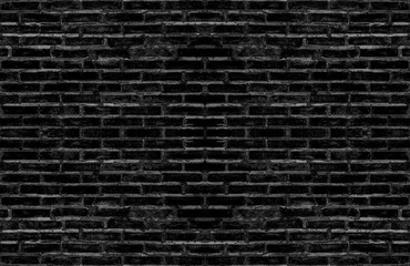 dirty old black brick textured wall for dark tone vintage interior design background. or brick mapping for 3d texture.