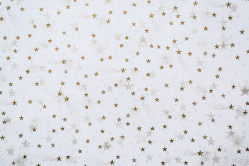 Abstract background with golden stars on a white background