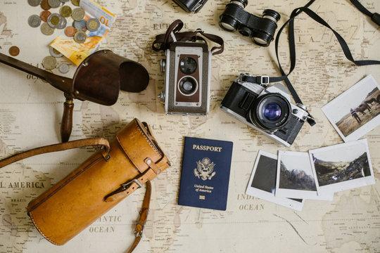 vintage map, film cameras, antique binoculars, passport and photo prints