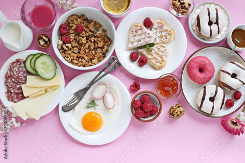 Brunch. Festive family breakfast set for Valentines day, Mothers day or Easter. Pink background. Overhead view, copy space