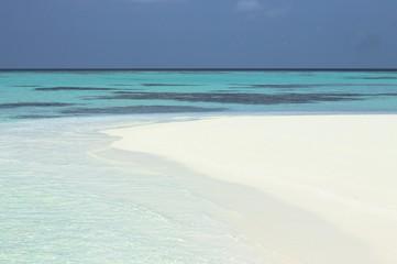 Beach of a desert island (Ari Atoll, Maldives)
