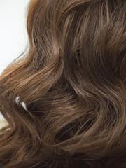 Papiers peints Salon de coiffure Brown curls of hair, female hairstyles.