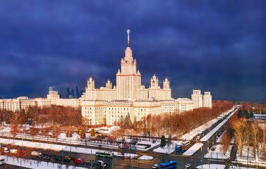 Vibrant aerial panorama of winter campus of famous sunset university with snowed trees in Moscow