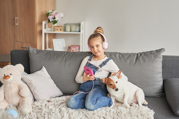 girl in headphones listening to music at home