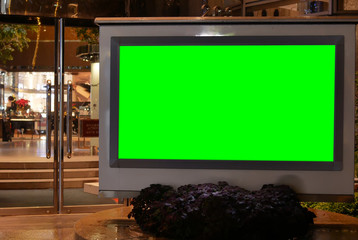 Close up of green screen billboard for your ad in front of the shopping mall