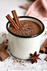 Fotobehang Chocolade Homemade hot chocolate in a white enamel mug on a light slate, stone or concrete background.