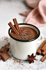 Fotobehang Chocolade Homemade hot chocolate in a white enamel mug.