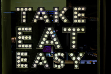 "luminous lettering "" take eat easy"""