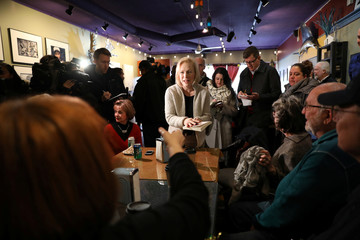 U.S. Senator Kirsten Gillibrand (D-NY) talks to customers at the Pierce Street Coffee Works while on a walking tour after announcing that she is forming an exploratory committee to enter the 2020 presidential race, in Sioux City, Iowa