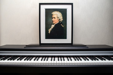 11.28.2018, Moscow, Russia. Wolfgang Amadeus Mozart - Portrait's photocopy of Burchard Dubeck painted in 1808 and piano keyboard.