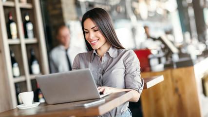 Business woman using laptop
