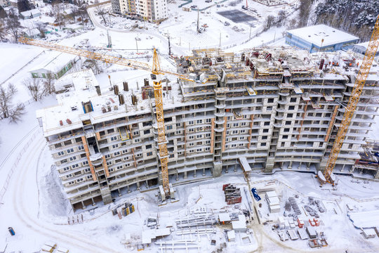 construction site in winter, aerial top view. building of new residential area