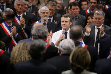 French President Emmanuel Macron addresses a meeting with the mayors of Occitania in Souillac