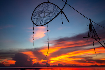 dream catcher silhouette on colorful sunset background