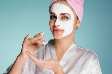 attractive young girl wants to look good, on wearing white nourishing cream on face