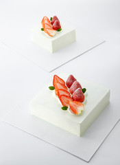 Delicate strawberry cake on white background