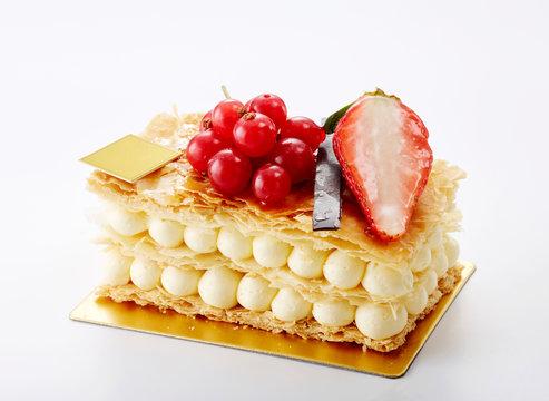 Delicious napoleon crumble cake on white background