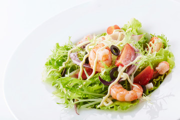 Delicious seafood salad on a white background