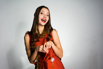 happy young girl celebrates the new year, received as a gift a red expensive bag