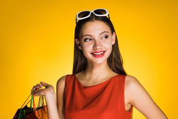 smiling attractive girl shopaholic bought many gifts for the new year 2018
