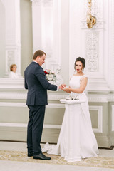 Solemn registration of marriage in the registry office. A couple in a Deluxe Suite.
