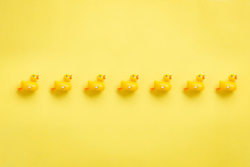 A roll of yellow duckies on yellow background,