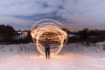 Long exposure. Yellow fire lines. Nightly winter landscape.