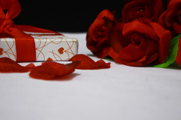 Photoshoot of Valetnine day gift boxes and ribbon with flower
