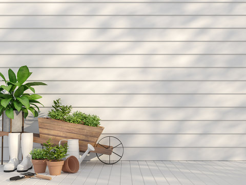 Outdoor terrace with garden equipment  3d render,There are empty white wood plank wall and floor,Sunlight shining to the wall with tree shadow.