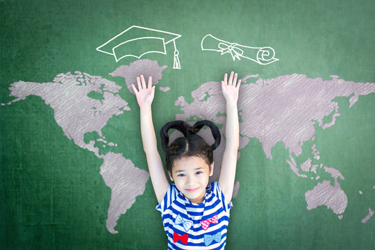 Scholarship opportunity and education success concept with school kid with doodle drawing of graduation cap on green chalkboard.